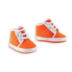 Oranje baby schoentjes in een hippe sneaker look. Dit zijn oranje kruipschoenen voor baby's. De eerste schoenen voor jouw kind of leuk om cadeau te geven.