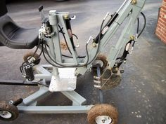 Mini Towable Backhoe by welderShane -- Homemade mini towable backhoe fabricated from cold rolled steel plate, flat bar, tubing, and angle iron. Hydraulic pump is powered by a 6 HP motor. http://www.homemadetools.net/homemade-mini-towable-backhoe