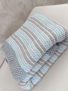 Photo only. Simple but effective blanket knit/purl