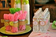 Decorated jars hold plastic utensils for a party