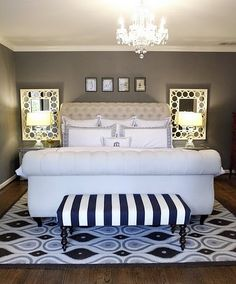 gray walls, white bed, striped bench