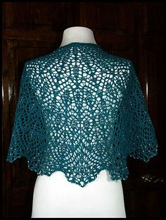 """Ocean Spray Beaded Lace Shawl"" knit in 100% Peruvian Highland wool fingering weight yarn with a beaded edging. Entire shawl used 517 silver-lined crystal clear AB beads (pattern by Anna Victoria)."