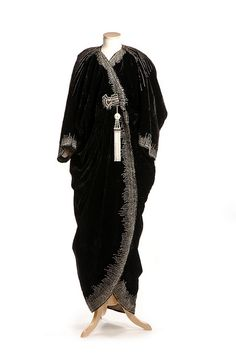 Black velvet evening coat c. 1912 With beaded ornamentation, this coat was designed by the couture House of Worth in Paris.