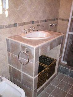 CASA QUINTA EN OLIVEROS: Baños de estilo rústico por Arq. Gustavo Piazza & Asociados