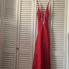 Red Prom dress criss cross tie back and crossed front design Worn once. Size 5/6. No stains or missing accessories Dresses