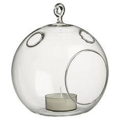 Featuring a hanging design, this lovely glass orb-inspired candleholder offers a touch of whimsical style for your sunroom or foyer.