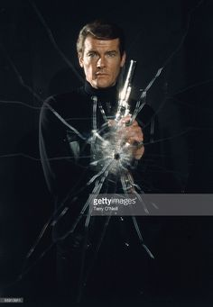 English actor Roger Moore poses as superspy James Bond for film 'Live and Let Die', directed by Guy Hamilton, 1973.