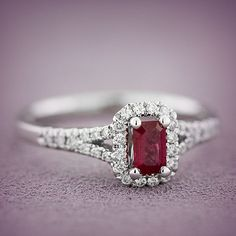 Emerald cut ruby ring with 1/5 carat total weight of diamonds, in 14K white gold.