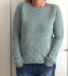 Worked seamlessly from the top down, this sweater features a raglan yoke, a lovely textured pattern band right before the bottom ribbing, and in-the-round construction for both body and the sleeves. The yoke begins with short-rows worked back and forth, then joined to work in the round with raglan increases. Twisted stitches add texture to the raglan lines. As this pullover is worked from the top down it is advisable to try it on from time to time to check the length and overall fit. The…