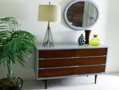 I have a mid century dresser with similar lines that needs an update.  I am not sure if I love this, but it is an option.