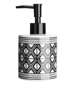 White/black patterned. Soap dispenser in stoneware with a printed pattern and a plastic pump. Diameter 3 in., height 6 1/4 in.