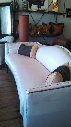 One of a kind curved white leather couch at The Buffalo Collection