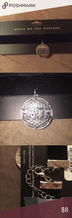 Bring Me The Horizon choker This is a choker necklace of the band Bring Me The Horizon. The necklace part is black, velvet material, and clasps in the back. The pendant is silver with the band's logo BMTH on it. Brand new, still on the package. Bravado Jewelry Necklaces