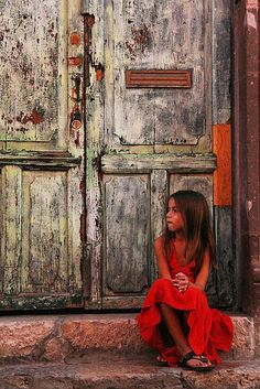"These doors reflect...many years. This young girl....seems to be ""reflecting""."