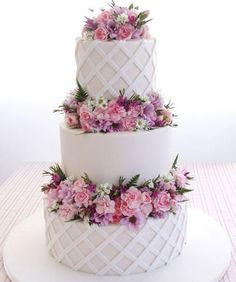 Fresh Country Lattice. Woven icing lattice add texture to this beautiful cake, finished with fresh seasonal flowers from Sweet Art
