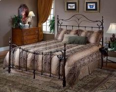 The Bennett Bed is a surprising twist on a traditional style. With elongated finials a sweeping footboard ornamentation, it's not your average old fashioned bed. This bed has a classic allure and is available in Full, Queen, and King.