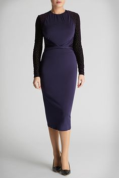 The Elliot dress has a waist defining slimming fit. This elegant evening option features semi sheer animal print inspired velveteen jersey devore panels, a cinched in waist with twist knot detail and a viscose crepe body for a comfortable yet sexy feel.