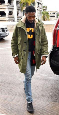 Kid Cudi Wears A Saint Laurent Parka Coat, Cardigan, Van Sneakers and Ray-Ban Sunglasses at LAX   UpscaleHype