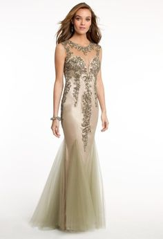Stride into elegance with this breathtaking evening gown and make a stunning statement. Details of this style include a mesh illusion neck combined with a beaded bodice, illusion beaded cap sleeves, wispy mesh godets and a tie back with open detail. Score this classic look...you'll surely want to wear this to many of your memorable events like Prom, Weddings, Galas and more! Complement your look with elegant heels, a clutch purse and statement-making jewelry for that ultimate evening look of…