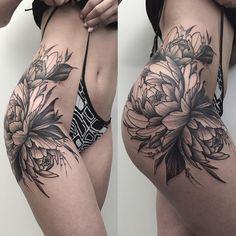 side thigh flower tattoo