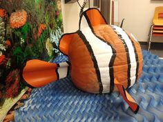 The back of Nemo pumpkin.  Painted stripes and cut corrugated plastic.