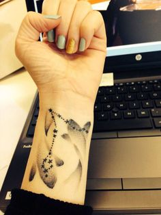 pisces zodiac tattoo on wrist