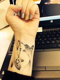 pisces zodiac tattoo on wrist