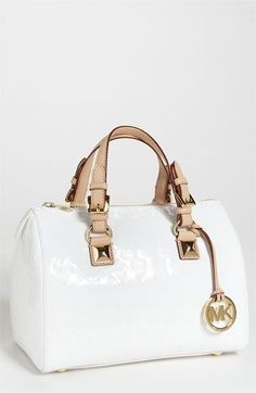 A purse that will go with anything is a girl's must have! This modern-like purse gives away a classy, stylish, and elegant touch to your style of the day.