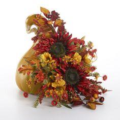 Gourd Pumpkin Arrangement •Gourd Pumpkin •Sunflower Picks (or flower of choice), 2 •Cosmos/Daisy Mixed Bush •Berry/Mixed Picks, 2 •Spanish Moss Cut square out of bottom right of pumpkin. Secure foam inside pumpkin...