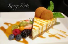 Vanilla Goat Cheese Cheesecake with Gooseberry Honey Coulis, Berries and Caramel.
