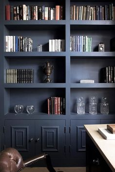 Part bookshelf, part built-in study, grays rule in this modern and cozy home office. Note the two-toned effect of the shelving and how it extends a hint of warmth against the paint. Not all built-ins