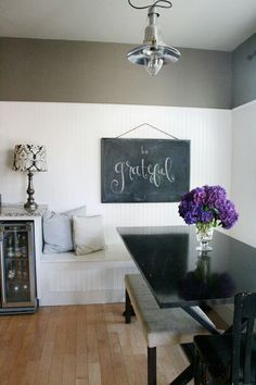jones design company ⋅ DIY large chalkboard for dining room. Patterned lamp shade, and high wainscoting walls, with breakfast bench / nook