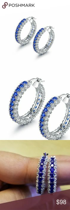 18k Sapphire Swarofski 3 row hoop earrings Brand new never used 18k White gold plated Swarofski element crystals clip back closure diameter 33mm . Not from the swarovski store. Swarovski Jewelry Earrings