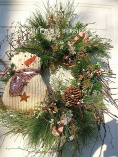 Christmas Holiday Winter Snowman Door Wreath Arrangement. $51.99, via Etsy.