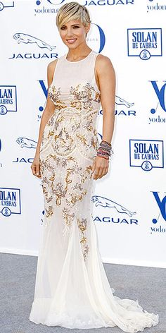 ELSA PATAKY Who needs a hot husband like Chris Hemsworth at your side when you have a head-turning dress like this one? (Actually, on second thought, can we have both?) The actress stuns in the embellished Zuhair Murad gown at the Yo Dona awards in Madrid.
