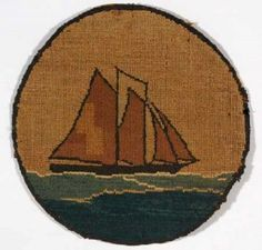 c. 1920 Grenfell Labrador Industries mat depicting a two-masted schooner with red sails and black hull sailing on a blue sea