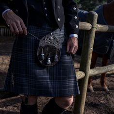 Pictured here is a Celtic Hound on Black Nguni sporran crafted in Cape Town by Afro-Celtic Sporrans. It pairs beautifully with the ash tones of the Hebridean Cairn tartan kilt. #meninkilts #choosewool #kiltmaker #sporran #scottishwedding #scottishheritage #groomswear #groomstyle #groomsmenstyle Kilt Wedding, Wedding Day, Kilt Hire, Tartan Kilt, Men In Kilts, Groom Style, Cape Town, Afro, Celtic