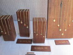 Great display for tiny series necklaces/pendants: IMG_5371 by renegadecraftfair, via Flickr