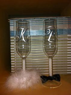 Bride/Groom champagne flutes and wine glasses. DIY wedding decorations  www.facebook.com/ULwithAng  www.facebook.com/ULbrides  http://angtresoorcarlson.uppercaseliving.net/Home.m