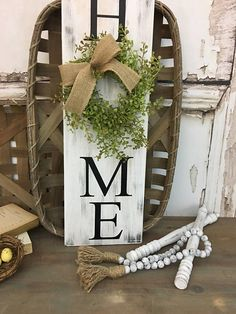 Vertical HOME sign with wreath 8x24 Vertical Home Sign Rustic Wreath Sign HOME sign Greenery Wreath Distressed Home Sign Farmhouse Decor   🌿🌿🌿🌿🌿  How cute is this?!  Vertical Home Sign with a mini baby grass wreath... Wouldnt this look adorable in a farmhouse styled home?! Add a