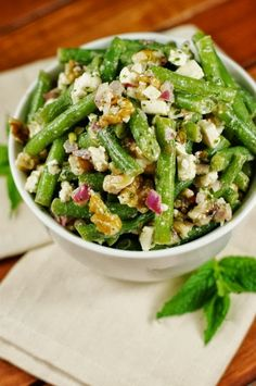 Fresh green bean with walnut and feta cheese dressed with fresh mint vinaigrette. #GreenSalad #HealthyRecipes #vegetarian #HealthySalad