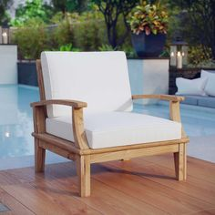 Crafted from teak wood and showcasing water-resistant cushions, this understated patio arm chair is a charming addition to your outdoor seating group. Its wood grain details pair perfectly with weathered wall Patio Lounge Chairs, Patio Seating, Tailgate Chairs, Wall Seating, Deck Patio, Office Chairs, Club Chairs, Side Chairs, Dining Chairs