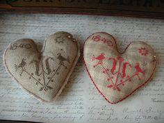 Sweet heart pinkeeps stuffed with sawdust.  Threadwork Primitives Design