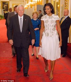 She looks lovely....First Lady Michelle Obama arrives at Buckingham Palace escorted by the US Ambassador