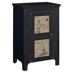 """One-door end table with New York and Paris motifs.Product: End table Construction Material: Fir wood and MDFColor: Distressed blackFeatures:  Full of charm, character and visual appeal Perfect for any room in your homeProvides ample interior storage space  Dimensions: 30.25"""" H x 19.25"""" W x 14"""" D"""