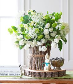 This simple to make vase would work for any flower arrangement.This says: Easter Floral Arrangements – Easter Tablescape Ideas - Good Housekeeping Easter Flower Arrangements, Easter Flowers, Flower Centerpieces, Spring Flowers, Floral Arrangements, Easter Centerpiece, White Flowers, Flowers Decoration, Spring Bouquet