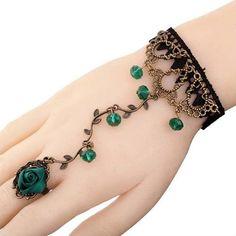 Pulsera de tela y aleación color bronce a juego con dijes color esmeralda y anillo con flor en mismo color. Odalisca. Cadena y anillo ajustables, complementos