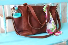 Why I love this leather carry on tote from Duluth Trading when I fly. It is so versatile and zippers so you can put it under your seat. | In My Own Style