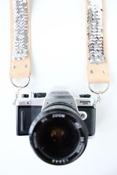 DIY no sew sequin camera strap. Wonder if you could use this for a guitar strap too