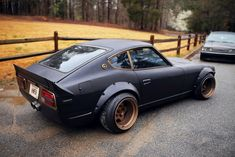 Yes. Yes! OMFG YES so much want right there. Matte black + bronze + center exhaust + wheel arches + ridiculous rims = awesome.
